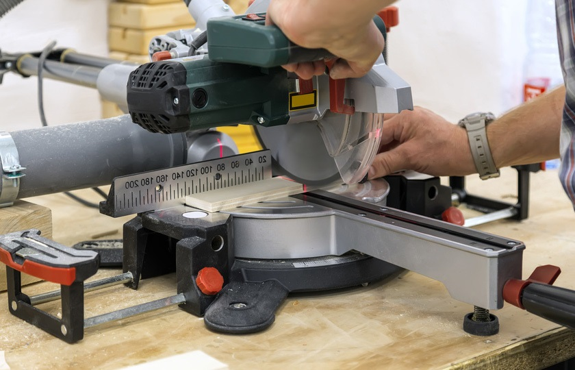 A miter saw with a pull function