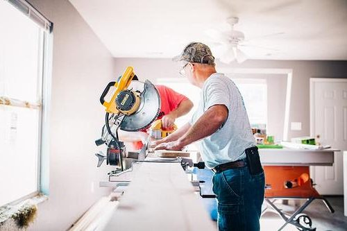 man working with the best sliding miter saw for homeowner