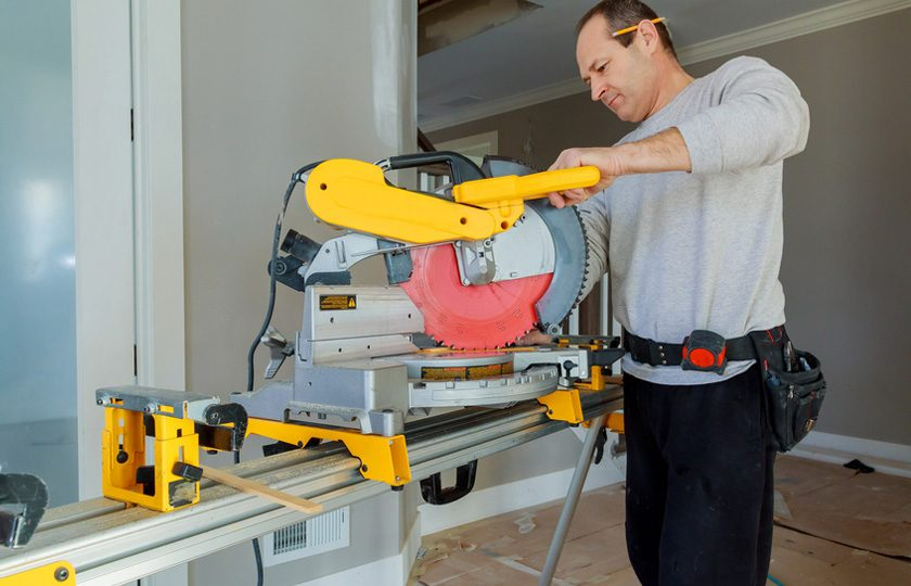 man working with a miter saw