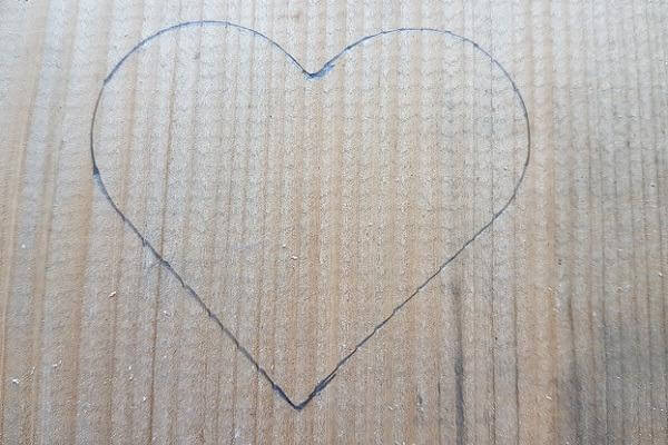 draw the heart on the wood