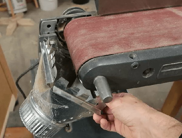 dust collecting on a benchtop belt sander